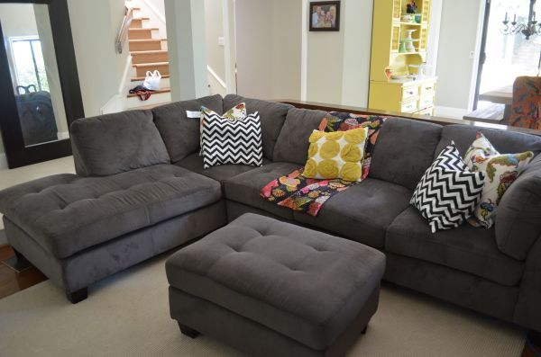 In love with grey sofa sectionals with Brightly colored throw pillows.