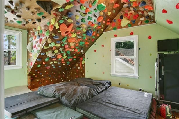 A home workout room with a rock climbing wall?!?! Now I've seen it all.  KUDOS!