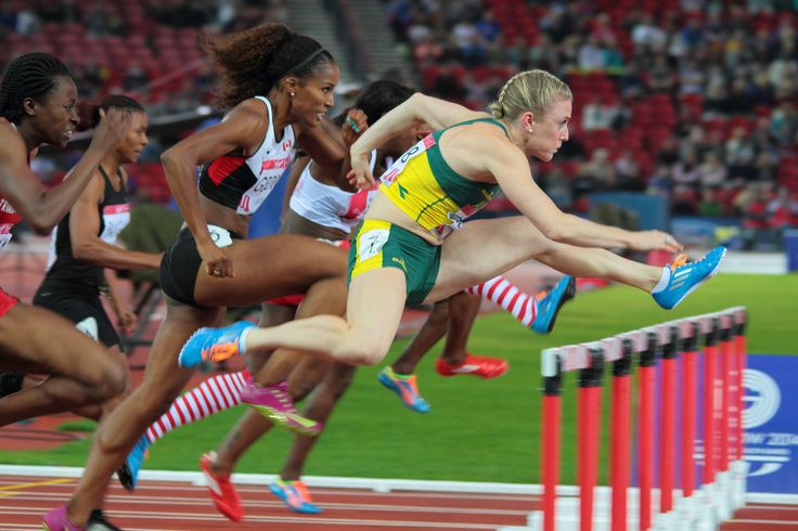 https://flic.kr/p/ogbVPA   Sally Pearson,Glasgow 2014 Commonwealth Games.   Australian Sally Pearson powers over the first hurdle at Hampden.