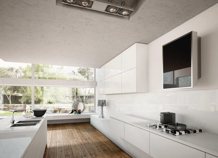 Extremely modern and compact in design, Titano draws on traditional hoods in terms of its square shape and positioning on the wall, offering the cooking area a truly innovative design and style.