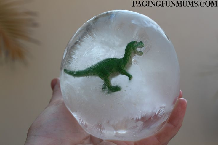 Frozen Dinosaur Eggs...a few of these in a bucket full of ice & bottled drinks would be so fun!