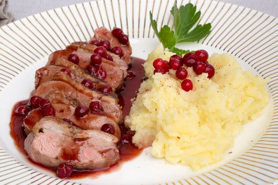 Duck breast with lingonberry sauce and mashed potatoes