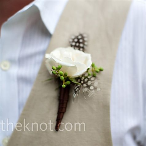 For continuity, brown spotted feathers were incorporated into the guys' boutonnieres; Ty also wore a white majolica spray rose.