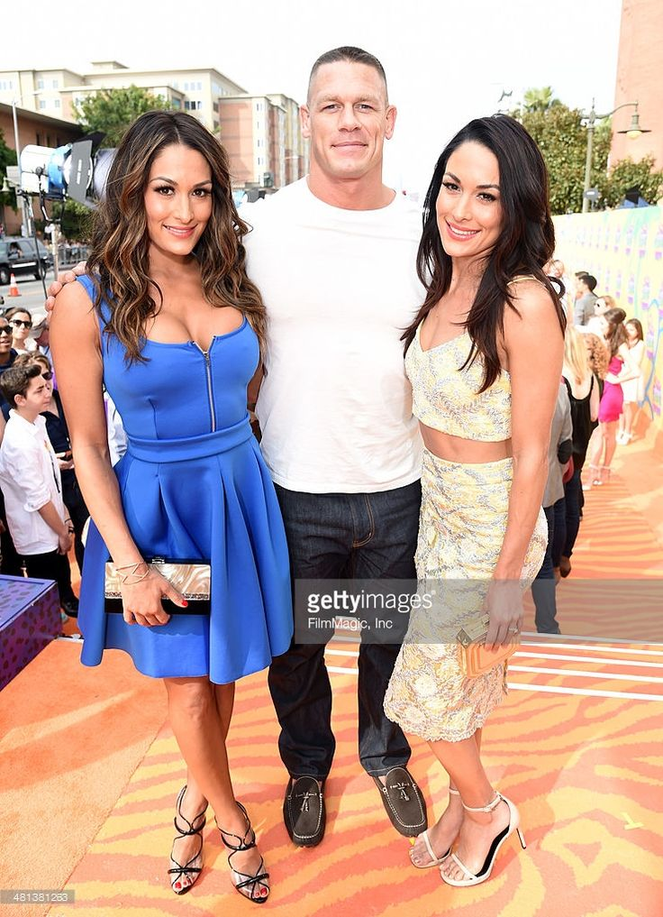 Professional wrestlers Nicole Garcia-Colace, John Cena and Brianna Garcia-Colace arrives at Nickelodeon's 27th Annual Kids' Choice Awards at USC Galen Center on March 29, 2014 in Los Angeles, California.