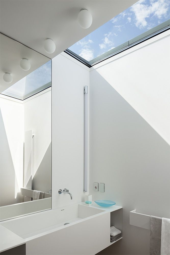 This bathroom features a skylight to allow more natural light in.