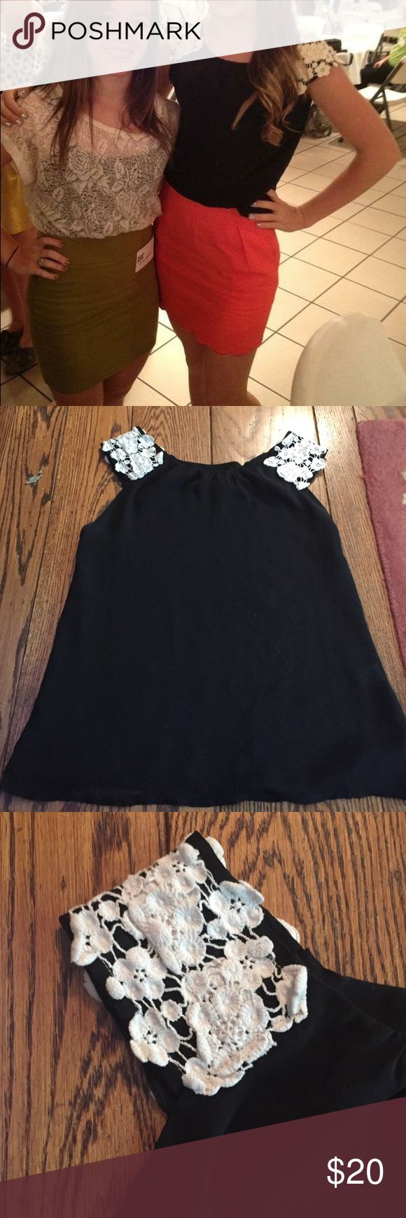 Black Top With Floral Sleeves In good condition! Can be casual or dressy. Kind of flowy; material is not stretchy. Tops Blouses