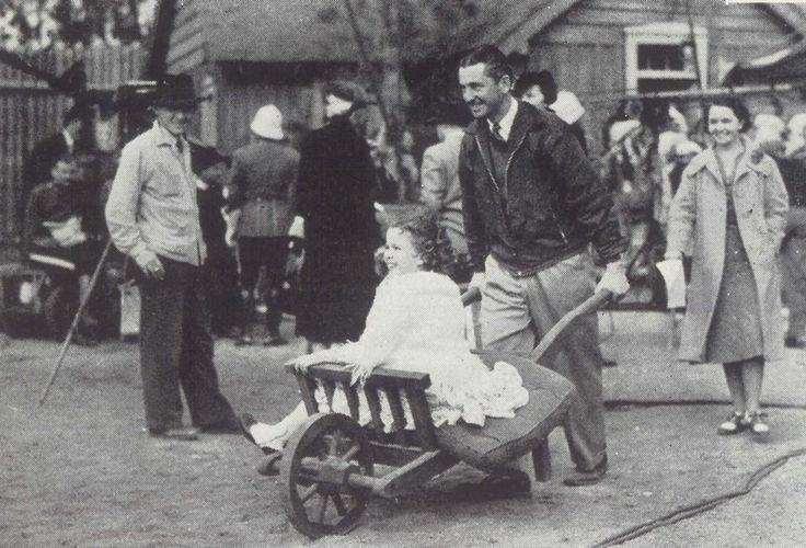 "don56: "" Shirley Temple gets a wheelbarrow ride across the backlot, 1930s. """