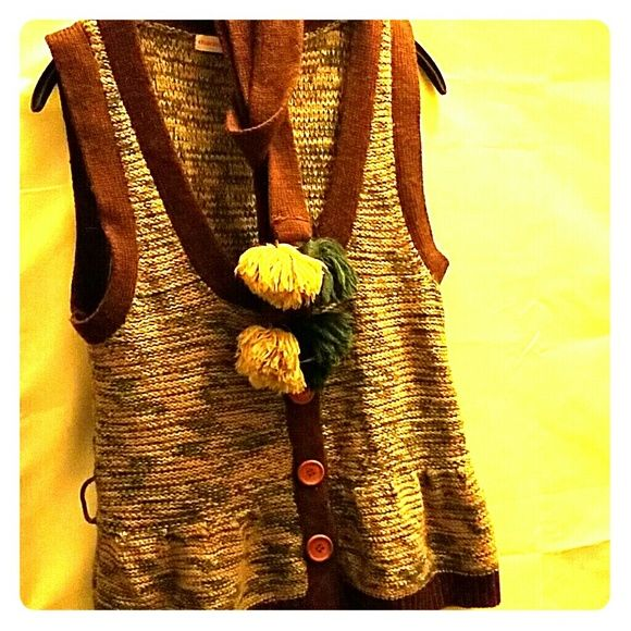 Charlotte Ronson knit bohemian vest with belt This vest has a turquoise, pink and cream mixed knit with brown trim. It also has a belt with cream and turqouise pom poms at end. Gently worn without tags. Also has large wood buttons. Charlotte Ronson Sweaters Cardigans