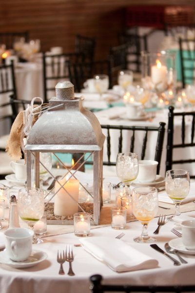 I think it's interesting how they have lantern candle holders on one table and votives on the other