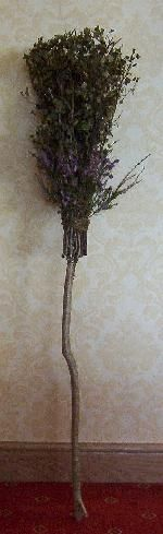 A besom. (this one is simply beautiful, stood on end and decorated with fresh flowers)