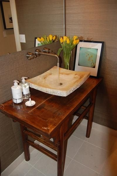 Suzie: Updated Half-Bath   Asian console table vanity with stone sink.  Grass cloth wallpaper ...