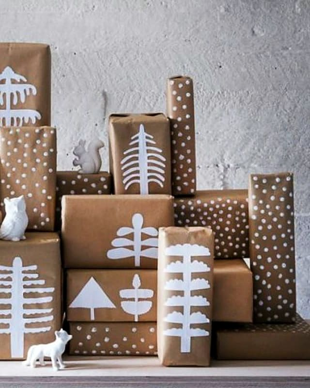 Add some festive cheer to your holiday presents by cutting simple wintery shapes out of plain white paper and adhere to kraft paper-wrapped packages. Your charming gift pile will double as decor!