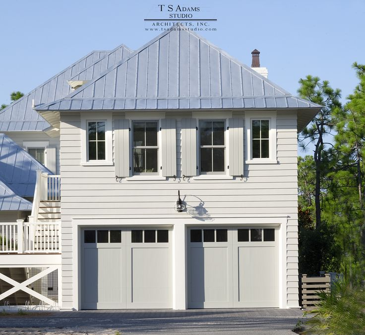 Carriage House in Florida with secondary suite above garage. Wood shutters and metal roof. Designed by TS Adams Studio.