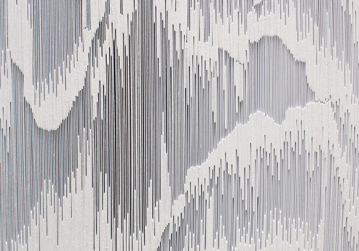 Tara Donovan's newest wall sculptures are composed of THOUSANDS of white styrene cards that are individually stacked, glued, and rotated 90 degrees.