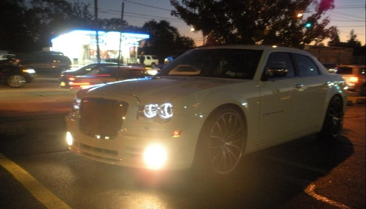 """KP's current G-Ride - Chrysler 300-S . V6, 280 HP, Bentley Grille, 20"""" Rims, Custom Stereo, DVD/Navigation, 5GB Harddrive, Sirius/XM, custom leather with Suede trim, custom stitching, moon/sunroof --- *UPDATE* -- Under Construction -- 22"""" rims on order and new  custom stereo complete by Rockford Fosgate """"Prime""""..(10 speakers including 2-12"""" Prime DVC subwoofers).  Custom neon lighting being installed by AAC Style."""