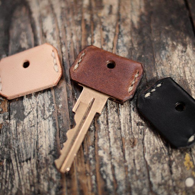 Buy small strips of leather and cut out key covers for all your keys, sew the sides and cut out a whole for the key ring.