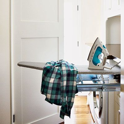 This folding ironing board stretches 3 feet out from behind a false drawer front. From Rev-A-Shelf, about $179; rockler.com. | Photo: Mark Lohman | thisoldhouse.com