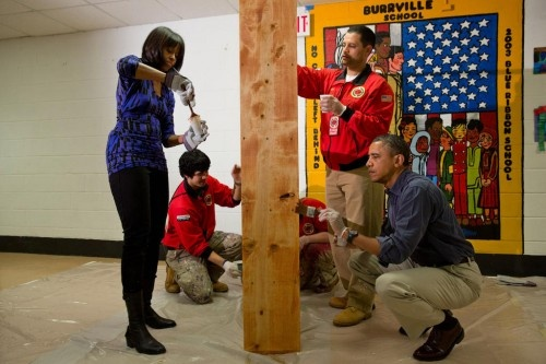 The First Couple put their money where their mouth is and got out and served the community today on the National Day of Service, helping stain shelves at Burrville Elementary in DC.