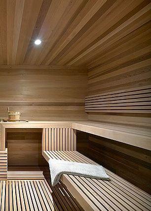 Modern sauna inside a Ski Chalet by Atelier Kastelic Buffey _