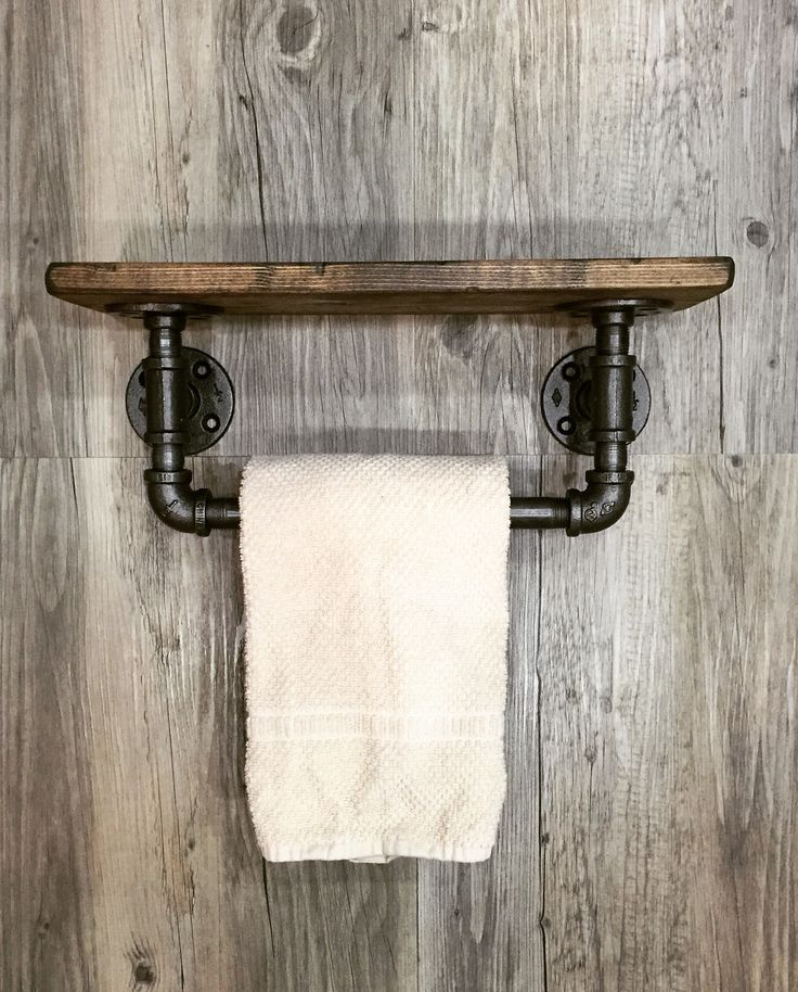 PLEASE KNOW THAT REGARDLESS OF SIZE, WE PROCESS ORDERS IN THE ORDER THEY ARE RECEIVED, TURN AROUND TIME IS 1-2 WEEKS PER ORDER!  This industrial, rustic, modern one of a kind towel bar holder with shelf it is a practical combination of 2 things in one. We have a must needed hand towel bar with an extra shelf for holding candles, a toilet paper, a small flower pot, a small picture frame and much more. The neat combination of wood and pipe will make everyone stop, stare and wonder!  Overview…