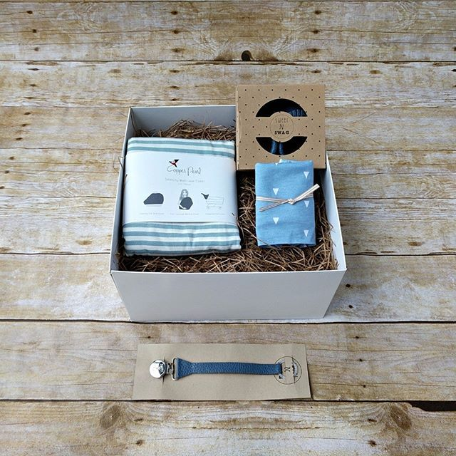 """Time to feature a boy's set! """"Little Boy Blue"""" is a sweet, classy set. It includes: -dusky blue baby moccs by Sweet N Swag -Dusky blue paci clip by Sweet N Swag -coordinating blue cotton bandana bib by Copper Pearl -blue striped stretchy Multi-use Cover by Copper Pearl  #luxbabybox #newmomgift #babyshowergift #bestbabygift #curatedgiftbox #babygiftbox #copperpearl #sweetnswag #babymoccs  #bestbabypresent #blueisforboys#paciflip  #babydroolbib #leatherpacifierclip"""
