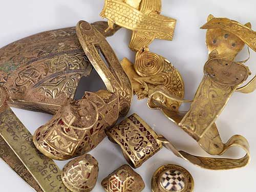 Using his metal detector, he found a hoard of more than 1,500 precious Anglo-Saxon military artifacts. The collection is 1,400 years old. Much of it is gold and silver of consummate craftsmanship, with arrays of tiny garnets cut to shape. Some of the items are unique and incomparable, making them nearly impossible to appraise or price. The trove likely belonged to a king