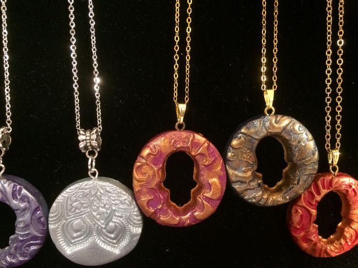Polymer hamsa pendants made by Nado & Lola #turkishhamsa #protectionpendant #evileye