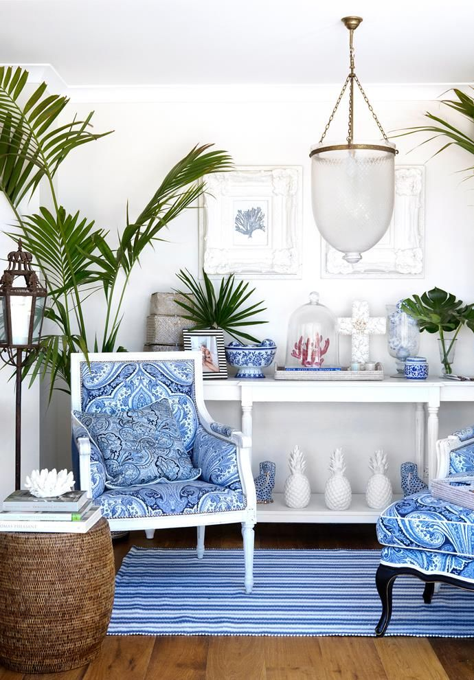 Natalee had antique armchairs repainted and upholstered in blue-and-white fabrics that reference her collection of classic ceramics. Rattan stools from Mandalay Designs.   Photo: Angelita Bonetti   Story: Australian House & Garden