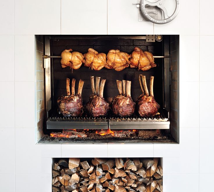 Such a pretty fireplace, and you can cook in it!!! The Obsessivore's Quest to Master His Wood-Burning Grill - Bon Appétit