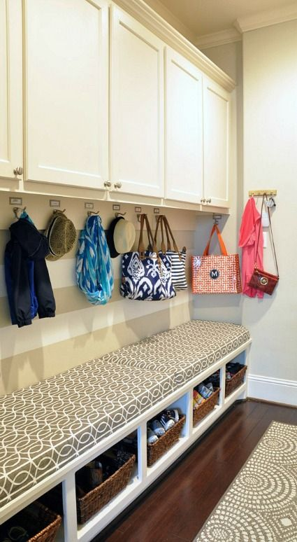 Organized mudroom with bookplate labels and hooks, built-in cabinets and bench seat  I like the cabinets to store/hide additional things...hats, etc.