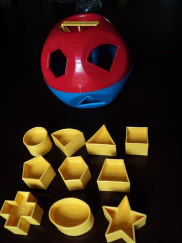 Tupperware Shape sorter... They don't make them like they used to...my parents still have one of these with all the shapes!
