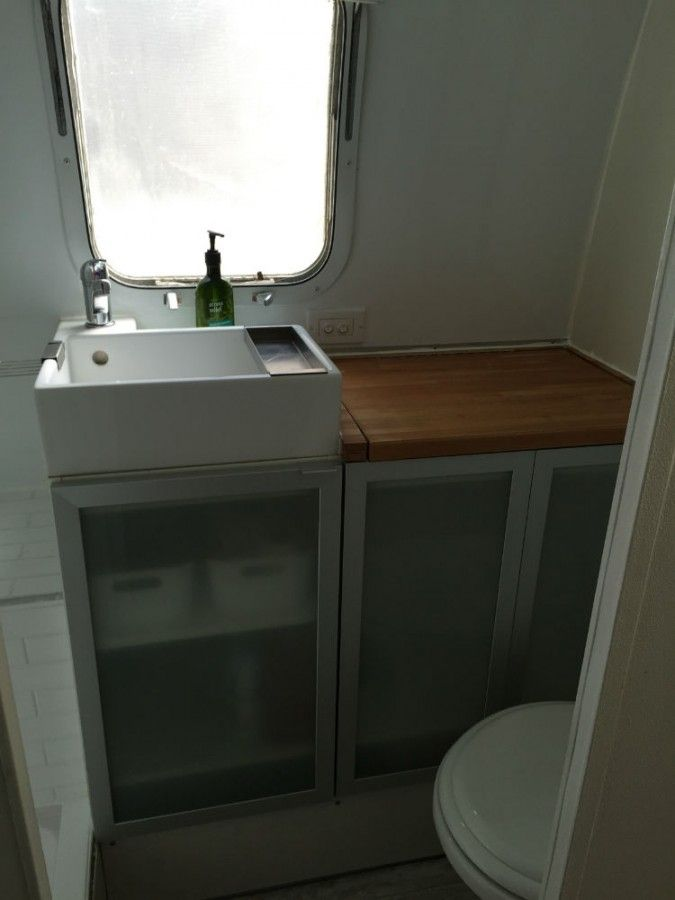 1979 Airstream Sovereign 31 - Massachusetts The perfect bathroom: above-counter sink (gives more storage space underneath), cheap modular (ikea) wood countertops (no cutting required), elegant cupoards, frosted window, notice Erin's Subway Tiles in the shower.