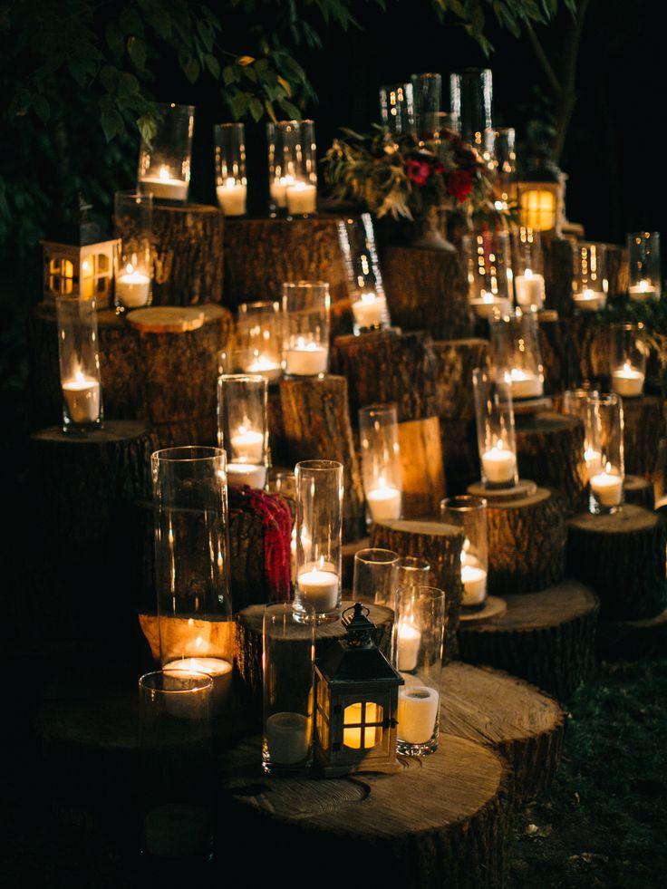 Night photo zone at the wedding: tree, candles, lanterns