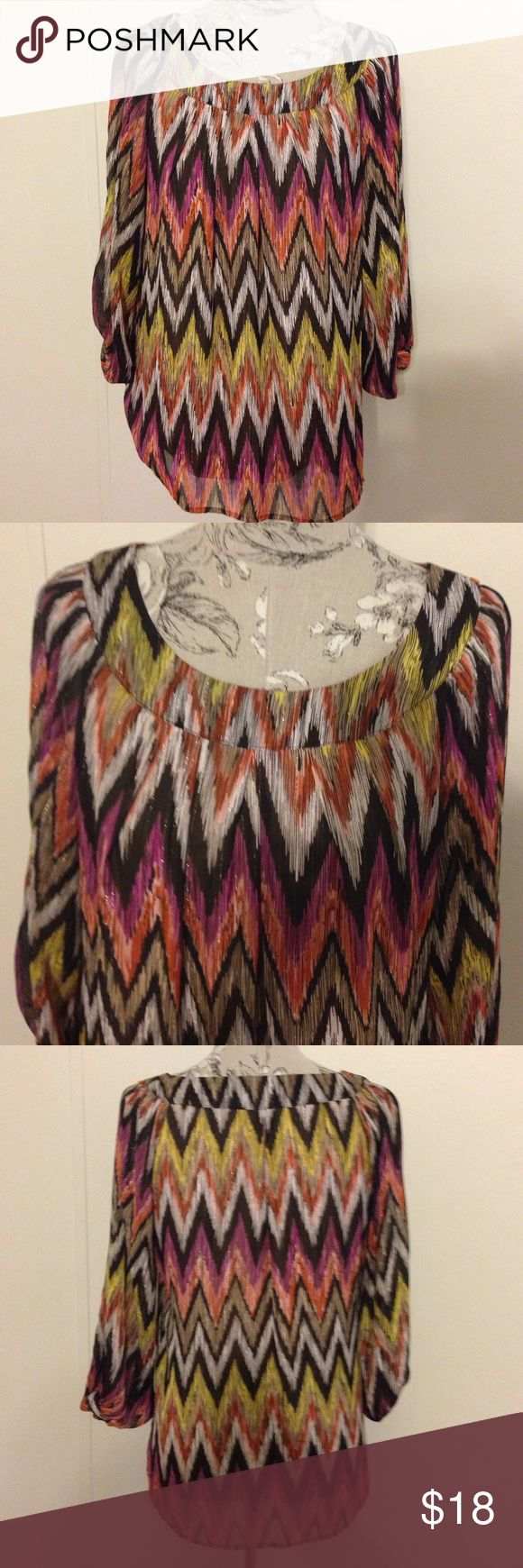Sara Michelle Chevron Top L Excellent condition. Lined and has shiny thread in fabric. Sara Michelle Tops