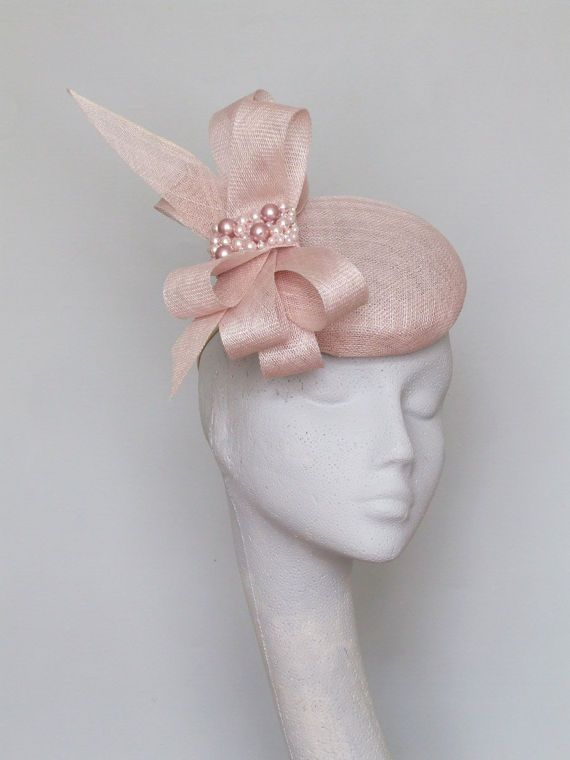 Pale pink hand blocked sinamay fascinator with sinamay loops and swarovski pearls. Secured by hat elastic. Please allow 5 business days for this item to be made. 14cms base fine for Royal Ascot.