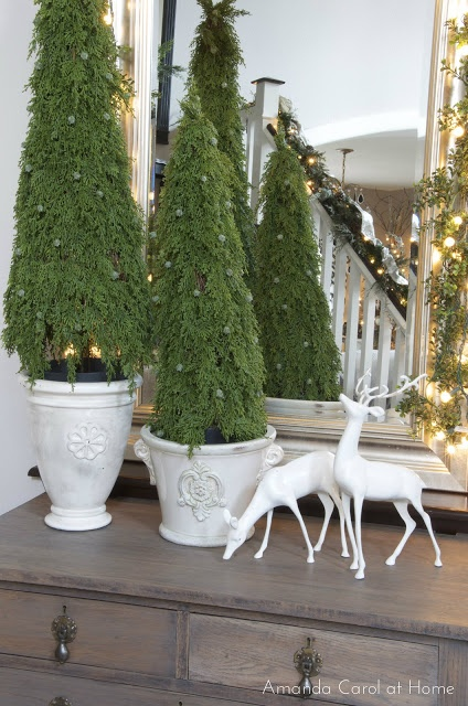 Thrift store reindeer painted white... Great idea for inexpensive #holiday decor!