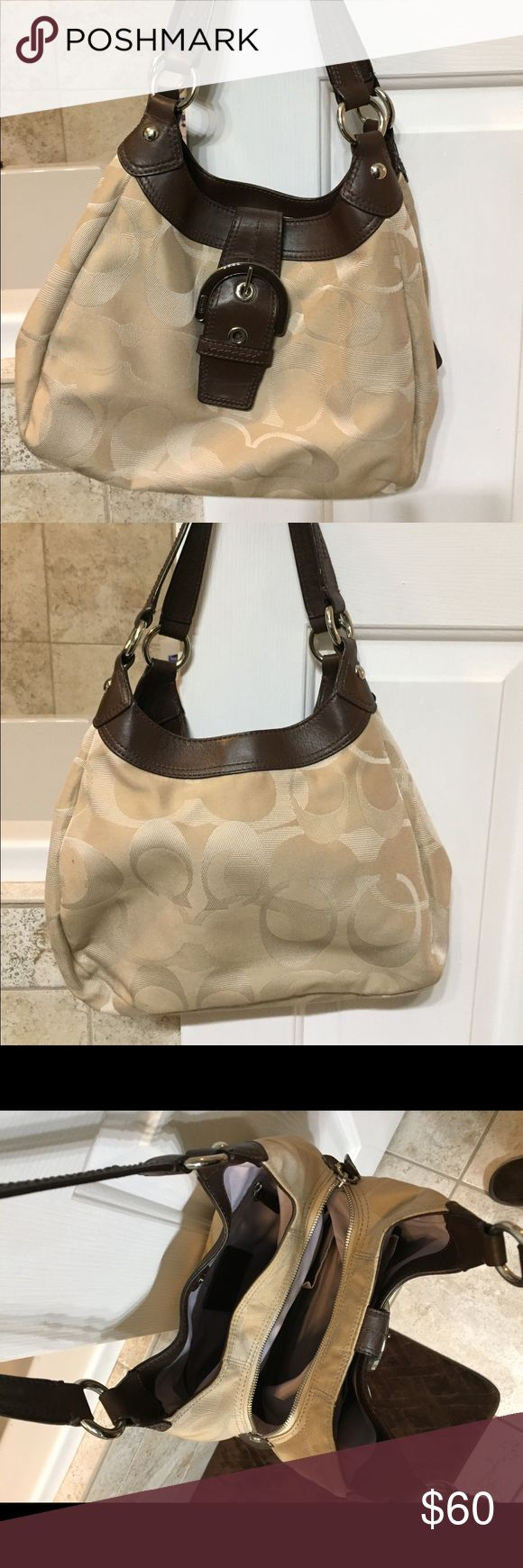 """Coach hobo bag Tan fabric with brown leather trim. Good used condition. Lots of organizational options with 3 different compartments- 2 snap closed and middle zippers closed. Light wear/small stains on bottom. I have not tried to clean. Otherwise in great shape.  Approximately 12""""Lx9""""Hx5""""W. 18""""L with handle Coach Bags Hobos"""