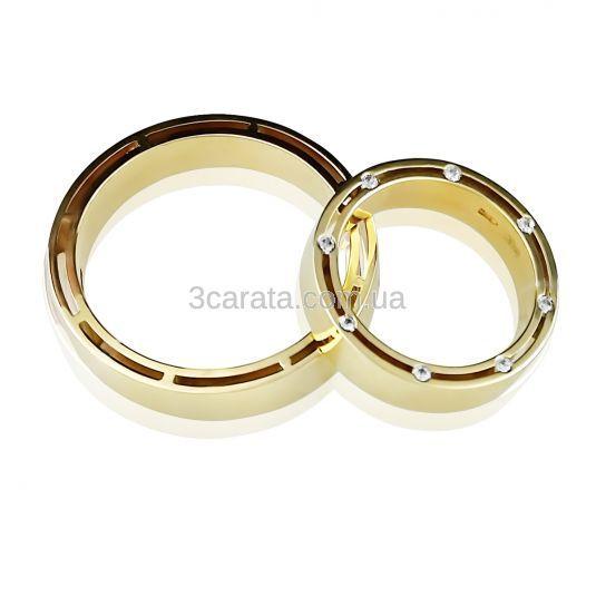 Золотые обручальные кольца станут лучшим украшением мужа и жены в самый лучший день! Двойное кольцо на свадьбу без вставок по дизайну от самого Бреда Питта, - возможна вставка камней. Золото 585 пробы.Цена за средний вес изделия 7 грамм.