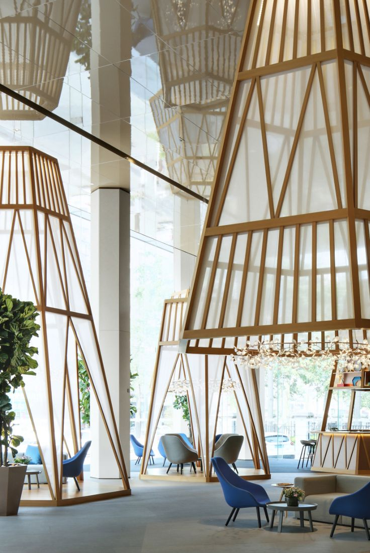 yuqiang + partners create a stark contrast between traditional and contemporary by revamping HappyLand's sales office in downtown changan.