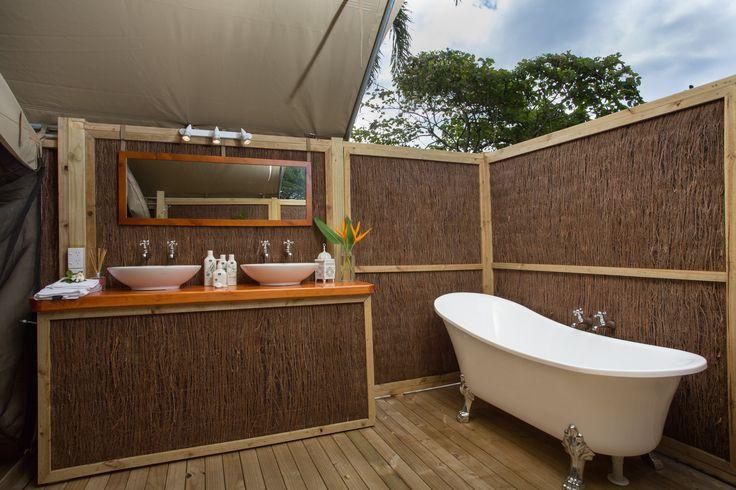 Enjoy a bath under the South Pacific stars at Ikurangi Eco Retreat, Ariki Tent  Rarotonga, Glamping, Cook Islands
