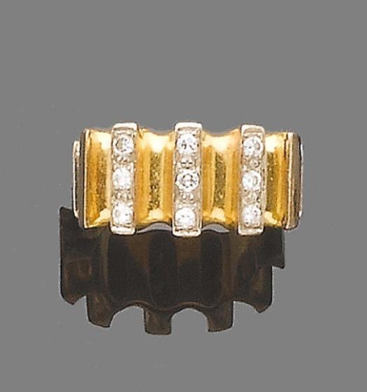 A diamond dress ring, by Stuart Devlin, 1974.  The bi-coloured 18 carat gold band, accented with single-cut diamond spacers, maker's mark, London hallmark