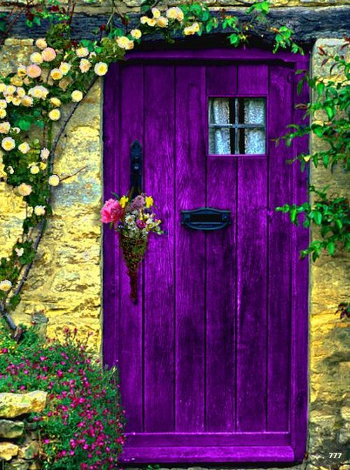 Gorgeous Purple Door.......I SHALL HAVE ONE JUST LIKE THIS INSTALLED IN ONE OF THE LITTLE COTTAGES DOWN IN MY PEACEFUL  PURPLE PETUNIA PATCH.........ccp