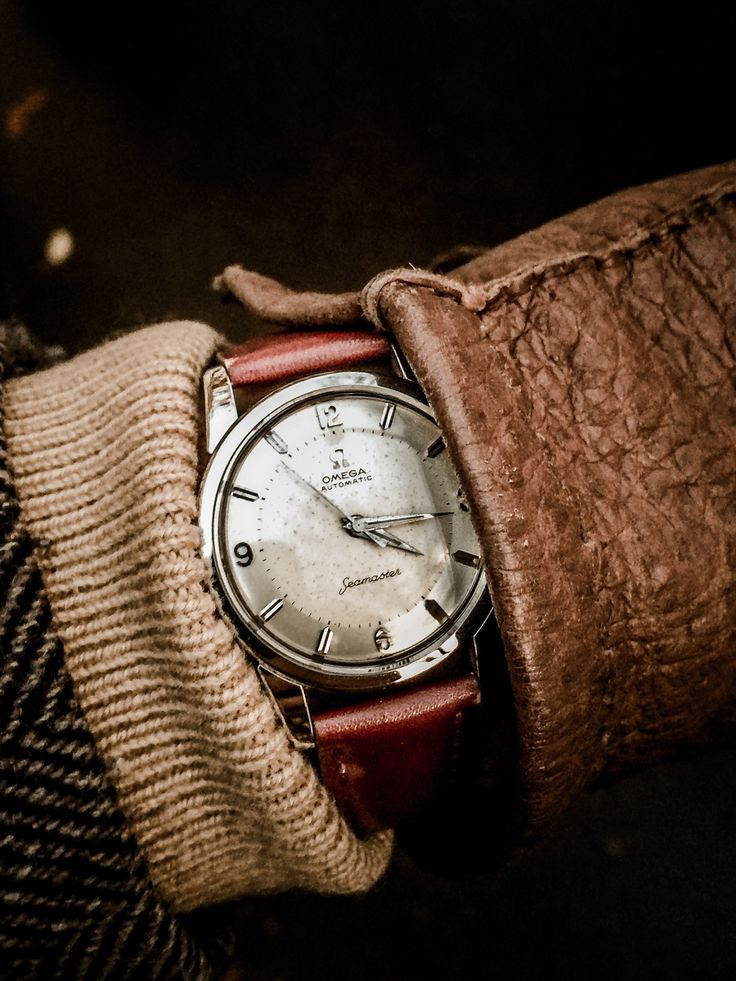 Men's accessories in warm shades of brown. Love this vintage watch and leather glove. Love this!