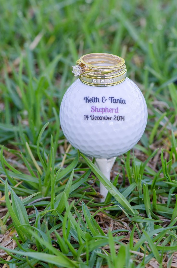 Wedding Photographer - Candid Photos of a Lifetime Wedding Rings, Engagement Ring, and a personalised golf ball.
