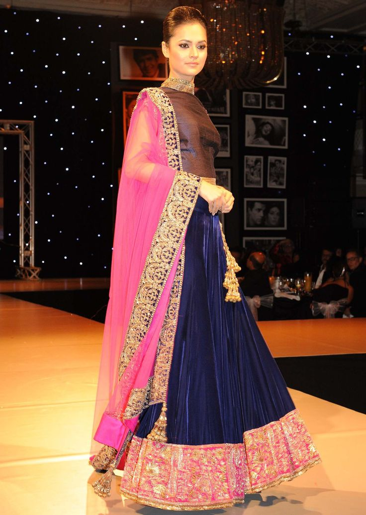 Models showcasing Manish Malhotra festive collection celebrating 100 years of indian cinema in London 12 - pink and blue rich embroidery lehenga