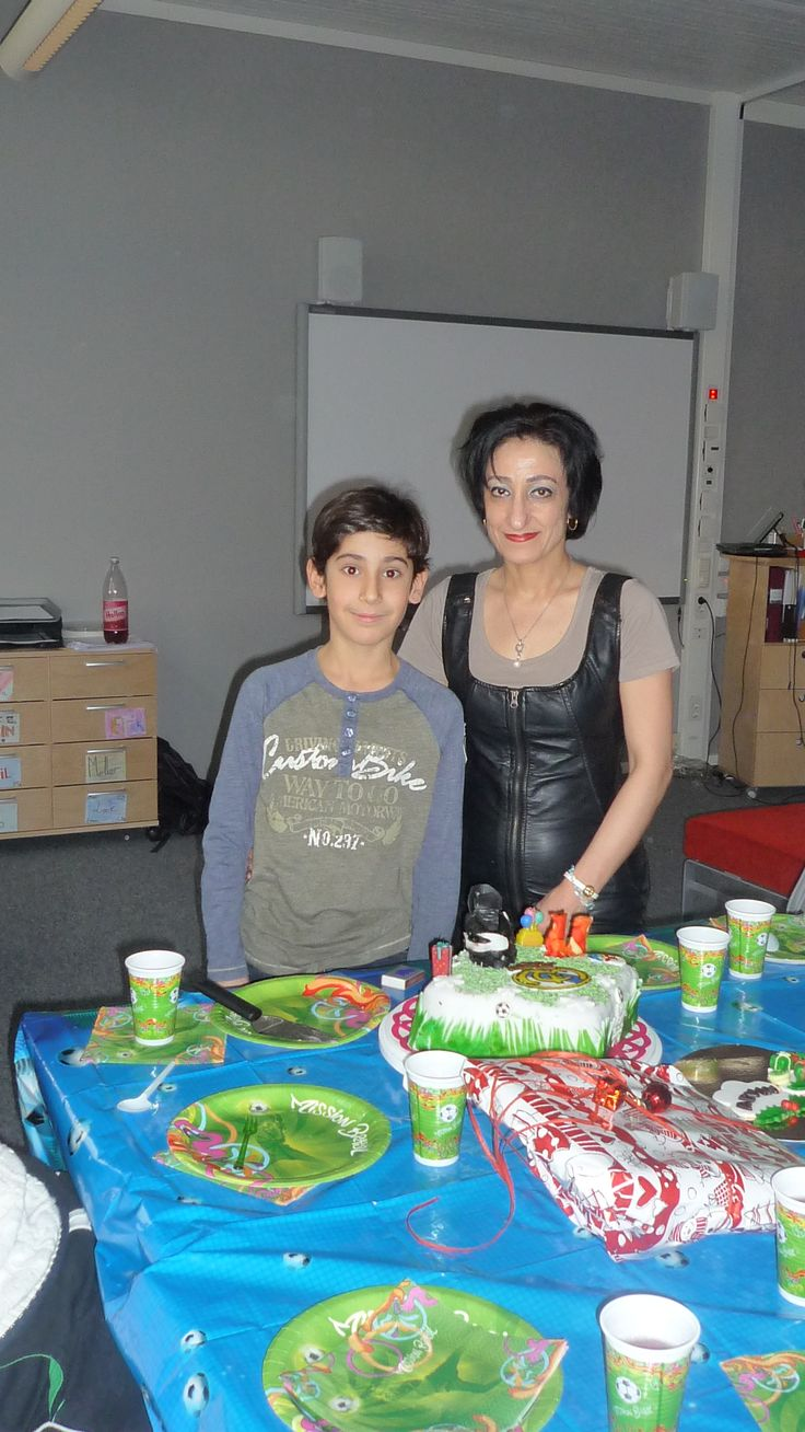 My son and me with football cake at school