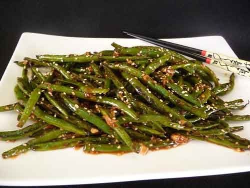 Szechuan Green Beans - these are very yummy but keep the exhaust fan running...they can smoke up the house. http://showmethecurry.com/fusion/szechuan-green-beans.html