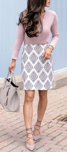 Woman wearing patterned pencil skirt with grey lace up heels. Pale pink sweater. #JellyShoesOutfit