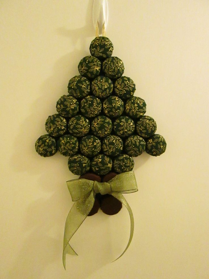 Wall hanging Christmas tree made from milk bottle tops