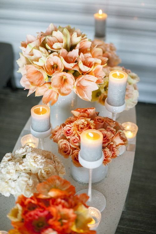 White, Peach And Coral Flower Arrangements Paired With Candles As  Centerpiece #wedding #peachcoral